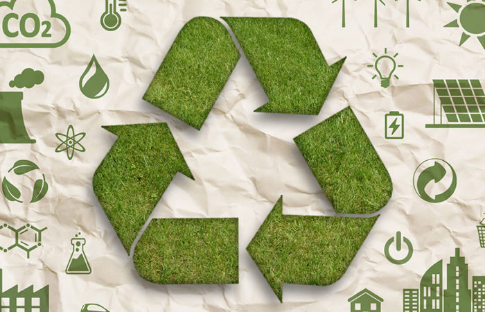 A recycling symbol made of grass on a brown paper background. Illustration.
